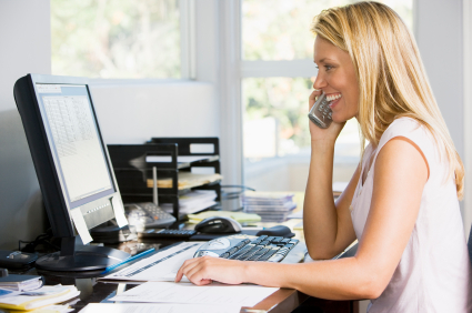 woman_smiling_desk_phone_computer