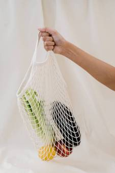 person holding a net bag